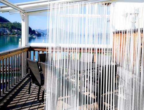 Balkongestaltung: Skydesign Sichtschutzzaun mit modernem Flair